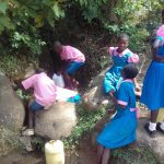 The Water Project: Kapsotik Primary School -  Waiting In Line To Fetch Water