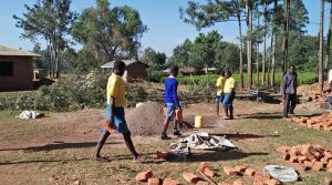 The Water Project:  Students Carrying Bricks To The Construction Site