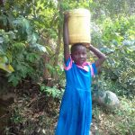 The Water Project: Kapsotik Primary School -  Carrying Water