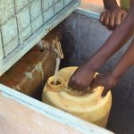 The Water Project: Ndaluni Primary School -  Rationed Water Fromt The Plastic Tank