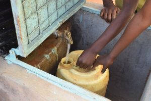 The Water Project:  Rationed Water Fromt The Plastic Tank