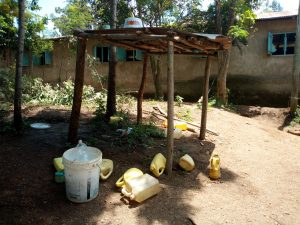 The Water Project:  Water Containers Scattered Around The Kitchen Area