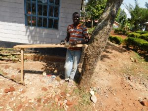 The Water Project:  Sanding A Latrine Door