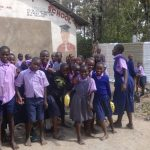 The Water Project: Ematetie Primary School -  Students Getting Water For Construction