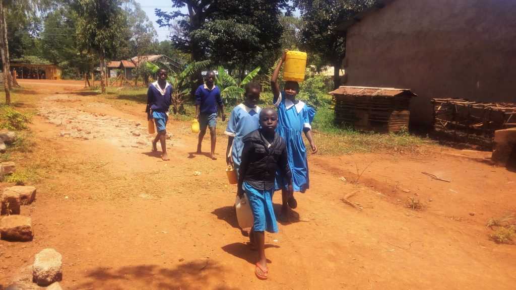 The Water Project : 2-kenya18074-students-bringing-water-from-home