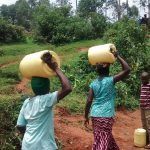 The Water Project: Jivovoli Community -  Carrying Water