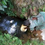 The Water Project: Muyundi Community -  Fetching Water