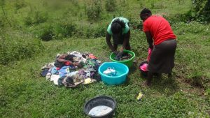 The Water Project:  Women Doing Laundry By The Spring