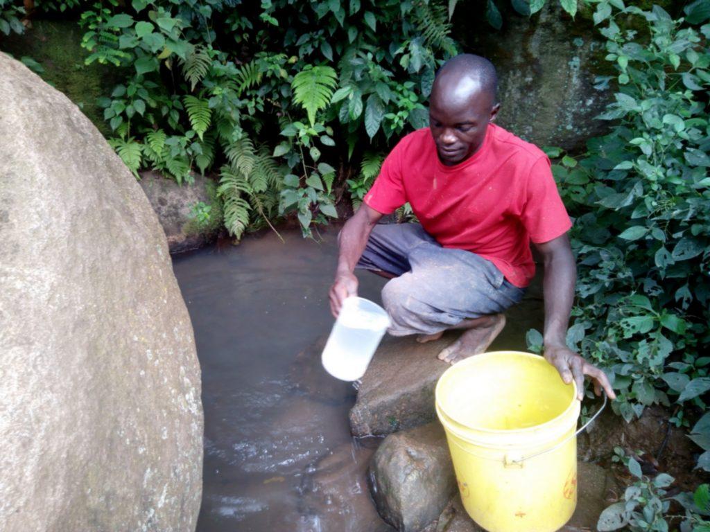 The Water Project : 3-kenya18124-mr-itevete-fetching-water