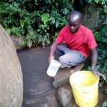 The Water Project: Muraka Community A -  Mr Itevete Fetching Water