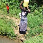 The Water Project: Mbande Community, Handa Spring -  Carrying Water