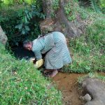 The Water Project: Muyundi Community, Baraza Spring -  Fetching Water