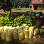 The Water Project: Isulu Primary School -  Water Containers Used By Students