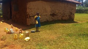 The Water Project:  A Little Girl With Her Water Container
