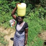 The Water Project: Mbande Community, Handa Spring -  Sarah Wamalwa Carrying Water