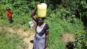 The Water Project:  Sarah Wamalwa Carrying Water