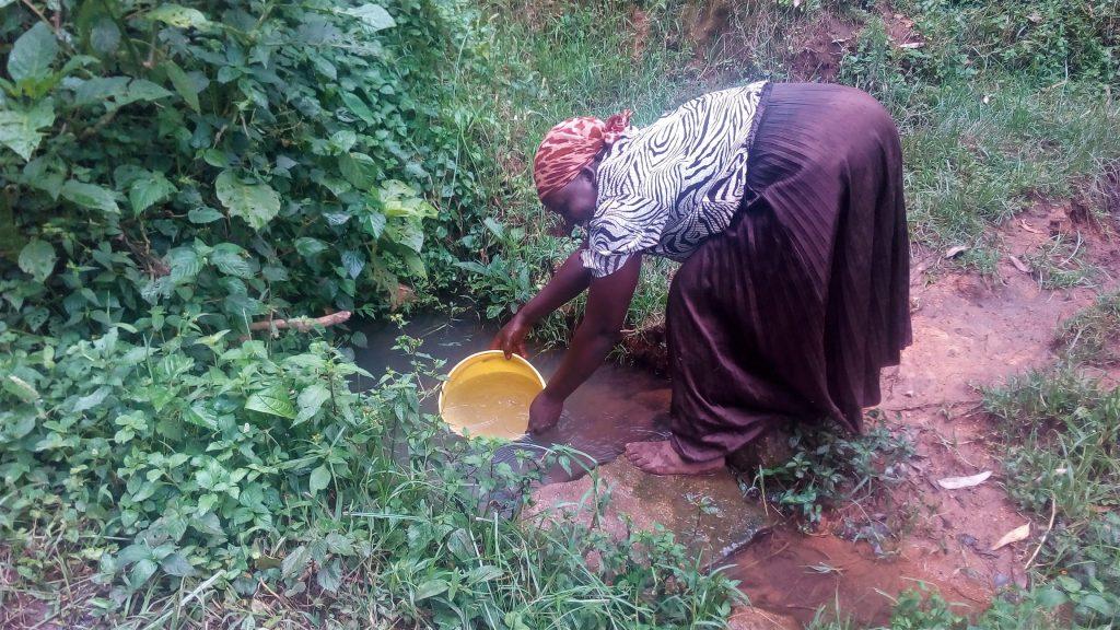 The Water Project : 4-kenya18157-mrs-pendi-fetching-water