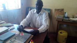 The Water Project:  Deputy Headteacher In His Office
