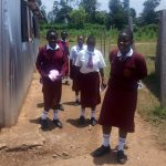 The Water Project: Shikhondi Girls Secondary School -  Girls Going To Get Water From The Plastic Tank