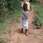 The Water Project: Jivovoli Community, Gideon Asonga Spring -  Carrying Water From The Spring