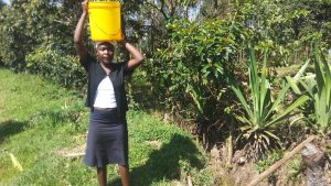 The Water Project:  Maurine Carrying Water