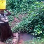 The Water Project: Koloch Community -  Carrying Water