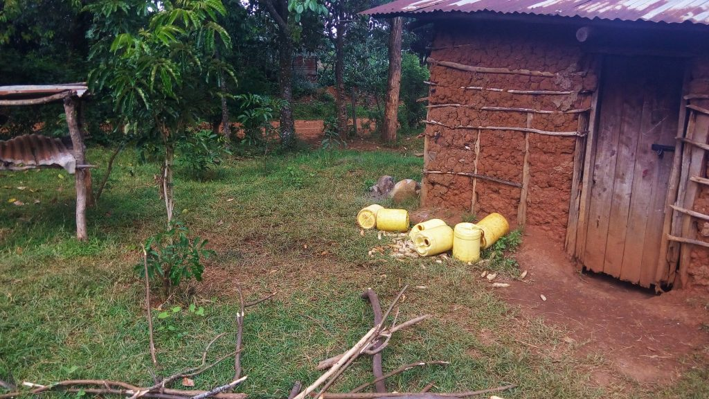 The Water Project : 6-kenya18041-water-containers-left-by-the-kitchen