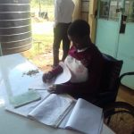 The Water Project: Joyland Special Secondary School -  Student Studying By The Plastic Tank