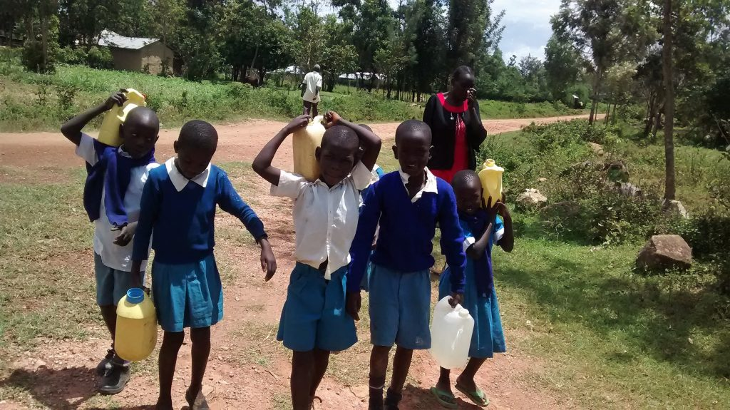 The Water Project : 7-kenya18020-carrying-water