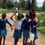 The Water Project: Rabuor Primary School -  Carrying Water