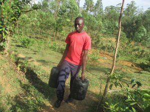 The Water Project:  Boy Carrying Water Back To School