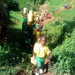 The Water Project: Jidereri Primary School -  Students Walking To The Spring