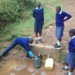 The Water Project: Kamuluguywa Secondary School -  Fetching Water