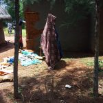 The Water Project: Mbande Community, Handa Spring -  Clothes Drying