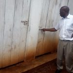 The Water Project: Essong'olo Secondary School -  Senior Teacher Showing Us The Latrines