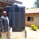The Water Project: Makuchi Primary School -  Headteacher At The Small Water Tank