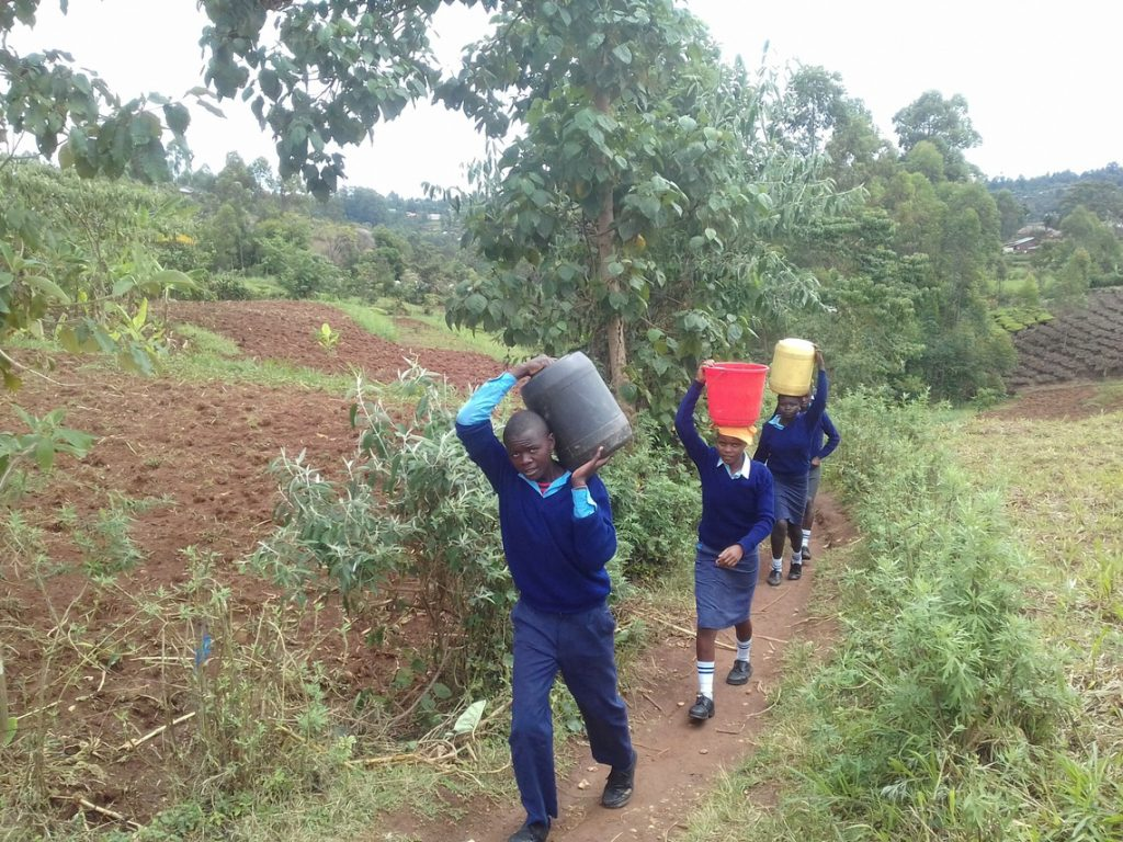 The Water Project : 8-kenya18055-carrying-water-back-to-school