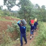 The Water Project: Kamuluguywa Secondary School -  Carrying Water Back To School