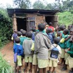 The Water Project: Gemeni Salvation Primary School -  Boys Queue At Latrines