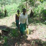 The Water Project: Gemeni Salvation Primary School -  Lugging Back The Water To School
