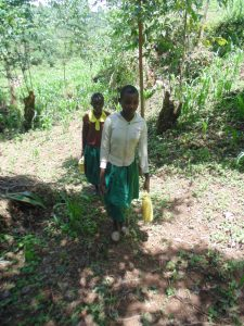 The Water Project:  Lugging Back The Water To School