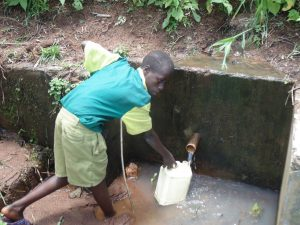 The Water Project:  Student Fetch Water From A Nearby Spring