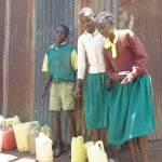 The Water Project: Gemeni Salvation Primary School -  Students Pose With Water Containers They Use To Fetch Water
