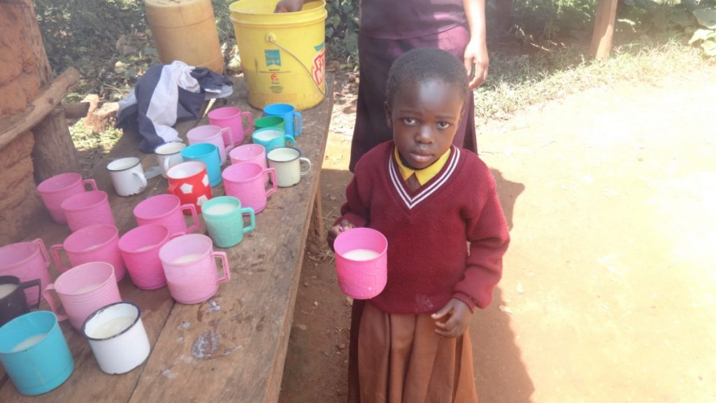 The Water Project : kenya18066-a-pupil-poses-with-her-porridge