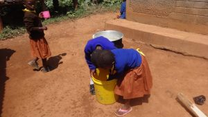 The Water Project:  Pupils Wash Hands In A Bucket