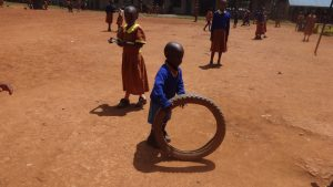 The Water Project:  Young Boy Plays With Tire