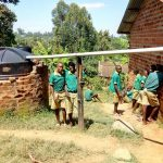 The Water Project: Muyere Primary School -  Students At Rainwater Tank