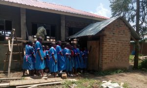 The Water Project:  Girls Line For Latrine
