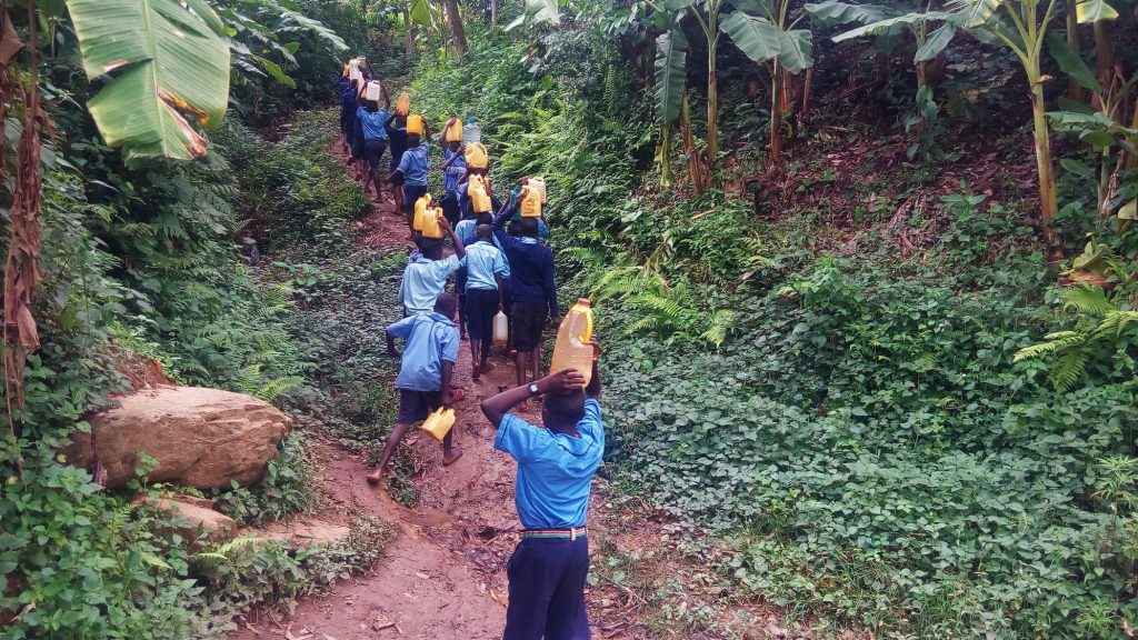 The Water Project : kenya18073-students-carrying-water-to-school-from-the-spring