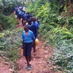 The Water Project: Shihimba Primary School -  Walking Down To Collect Water